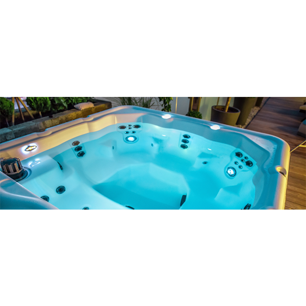 A hot tub model that has being filled and that is on display in showroom of Dyer pool store.