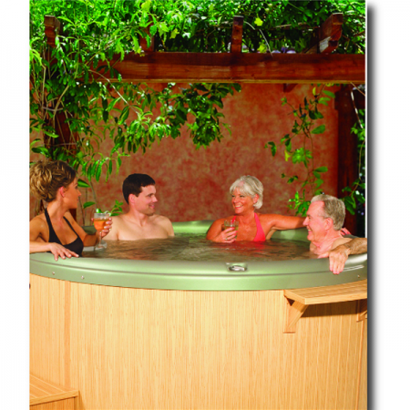 People in a round hot tub, that was professionally built by Dyer spa contractors.