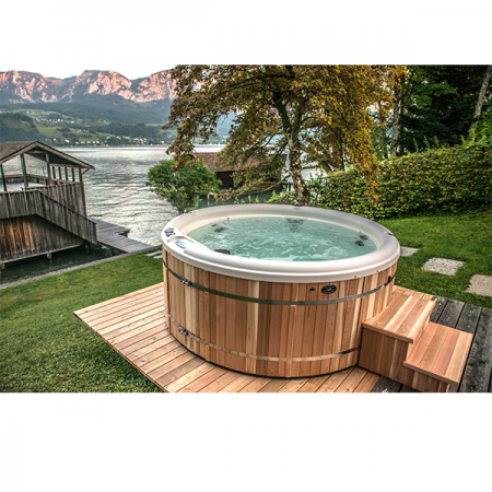 Round spa in mountain setting, that is an option when looking to buy hot tub Northwest Indiana.