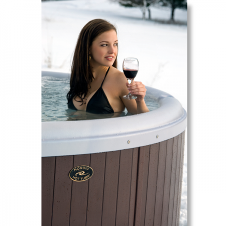 Woman sitting in spa with glass of wine, that was professionally built by Crown Point spa contractors.