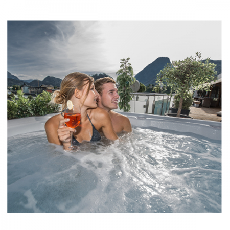 A young couple relaxing in spa that was professionally installed by Dyer hot tub contractors.