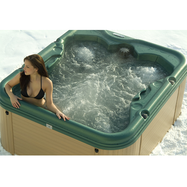 A woman in a bubbling hot tub that is on display in showroom of St John spa store.