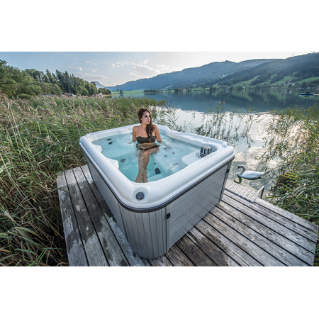 Girl in hot tub in a mountains, that is an option when looking to buy hot tub NW Indiana.