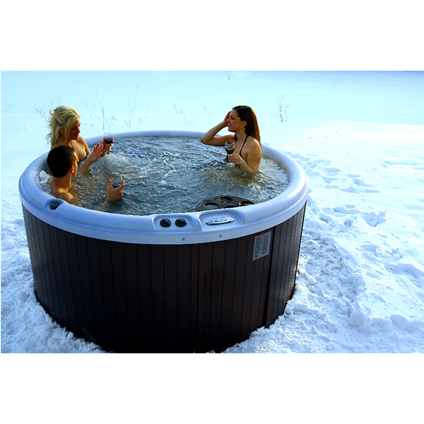 A round hot tub that is sitting in the snow, that is an option when looking to buy hot tub Orland Park.